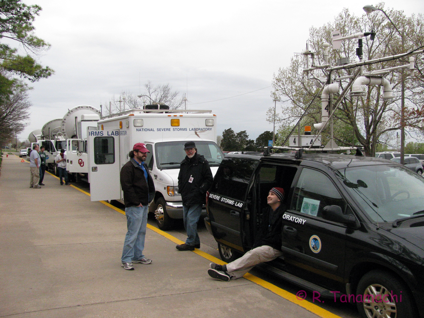 Mobile mesonet, field command vehicle, and radar trucks parked outside the OKC Science Museum.