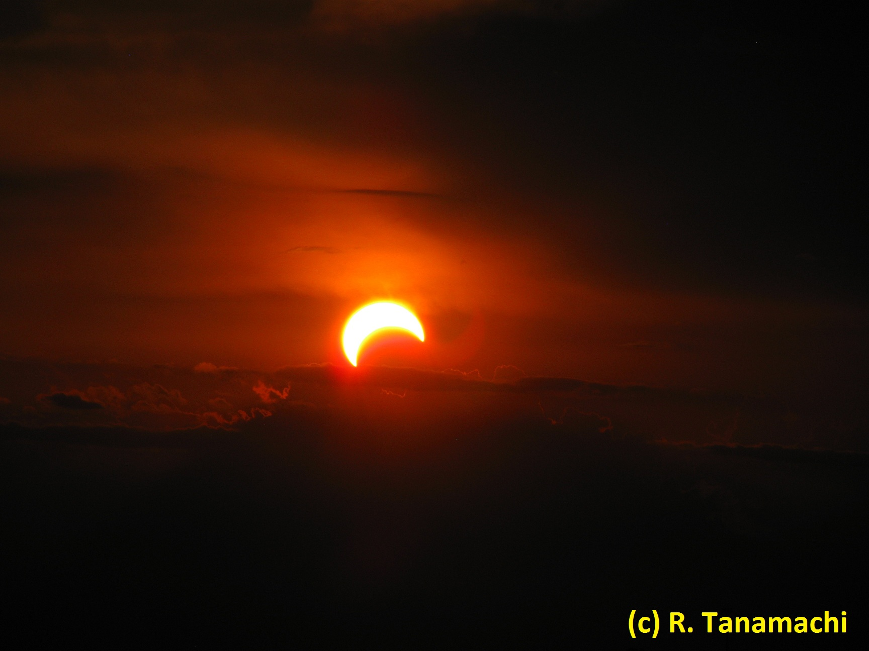 The sun, about 50% covered by the moon's silhouette